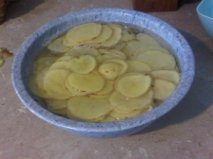 sliced potatoes in bowl