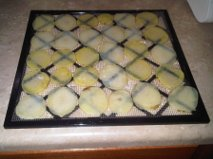 raw potatoes on tray
